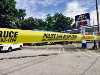 Durham police shot a robbery suspect early Saturday morning after he allegedly killed a person at the Joy Food Mart on North Roxboro Street.