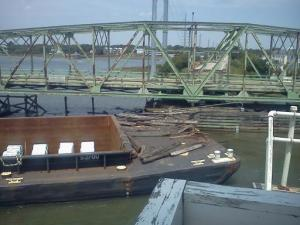 A barge being pushed by a tugboat in Surf City struck the Topsail Island Bridge Sunday. (Photo courtesy: Patsy Ligon)