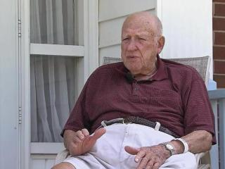 A 93-year-old Raleigh man says he was bitten by an 'aggressive fox' Sunday afternoon while sitting on the front porch of his home, just off Six Forks Road.