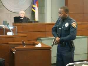 Durham police officer Kelly Stewart reenacted his confrontation with Carlos Riley Jr. during testimony on Aug. 4, 2015.