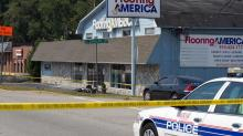 IMAGES: Motorcyclist crashes into Fayetteville business, dies
