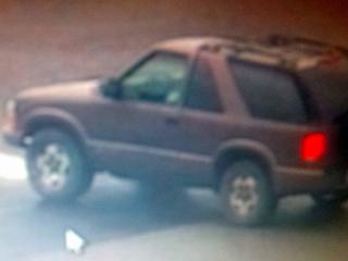 A surveillance image shows the getaway car in a Raleigh bank robbery Tuesday, Aug. 11, 2015.