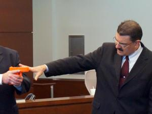 Defense attorney Alex Charns, right, tries to demonstrate during his Aug. 12, 2015, closing argument that Carlos Riley Jr. couldn't have shot a Durham police officer during a 2012 traffic stop.
