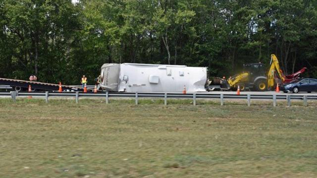 An overturned trailer closed southbound Interstate 95 near Rocky Mount for several hours Friday morning, the North Carolina State Highway Patrol reported. Photo by John Payne.