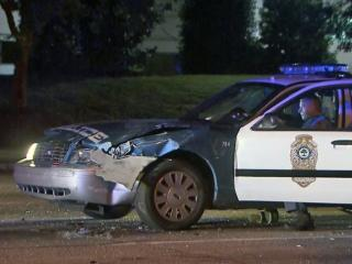 Raleigh police were searching for a silver Dodge Charger Friday morning after the car crashed into a police cruiser and another car after running a red light.