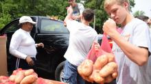 IMAGES: Duke University bags thousands of potatoes to feed the hungry