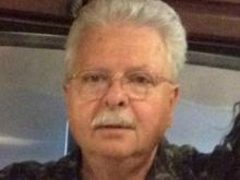 The victim has been identified as the proprietor of Mr. Pawn, Thomas Melvin Durand, 64.