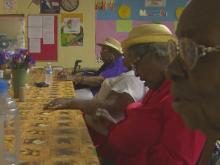 Little Harrells quilters find warmth at community center