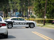 An armed man threatening to commit suicide was shot and killed by Durham police officers Saturday morning after he pointed a weapon at authorities, Police Chief Jose Lopez said.