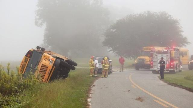 A Wayne County school bus is seen on its side after a crash on Shady Grove Road in Mount Olive on Sept. 9, 2015. (Photo courtesy of The Goldsboro News-Argus/Melissa Key)