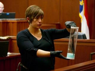 A crime scene investigator shows a knife during the Joanna Madonna murder trial.