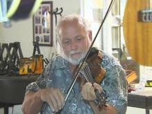 Thomasville man gives voices to old fiddles