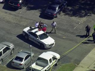 A man died Tuesday morning in a shooting behind police headquarters in downtown Durham, authorities said.