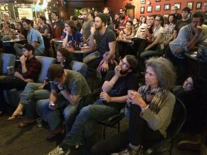 People gathered around the television at watch parties around the Triangle to hear what the candidates had to say during the first Democratic debate.