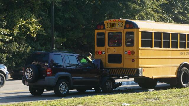 Two students were taken to Cape Fear Valley Medical Center Friday morning after a small SUV hit the back of a school bus in west Fayetteville.