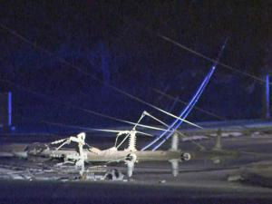 Raleigh police shut down a section of Blue Ridge Road early Monday after a wreck involving a taxi brought down power lines.