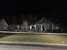 The fire broke out just before 6 p.m. at a home on Breezewood Drive near Lillington in Harnett County.
