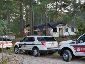An unidentified man died early Tuesday when fire tore through a home on Auburn Church Road in Garner, fire department officials said.