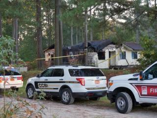 An unidentified man died early Tuesday when fire tore through a home on Auburn Church Road in Garner, fire department officials said.