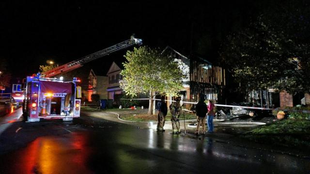 Three people were displaced early Wednesday when fire ripped through two homes in a northwest Raleigh neighborhood.