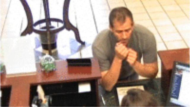 Surveillance images from a Hernando County (Tenn.) bank robbery appear to show Lanson Stalf, who has robbed a bank before and is wanted for the murder of his wife in Wake Forest.