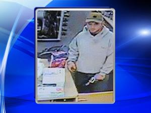 An image from a security camera shows a man robbing a CVS pharmacy in Aberdeen on Oct. 29, 2015. Police say the man is wanted in a double-homicide in Davidson County.