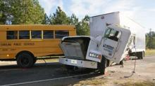 IMAGES: One seriously hurt when tractor-trailer, school bus collide in Moore County