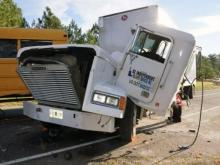 A passenger in a tractor-trailer was taken to UNC Hospitals Friday morning after the truck was involved in a collision with a Moore County school bus, fire department officials said.