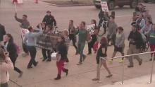 IMAGE: Immigration advocates march in downtown Raleigh