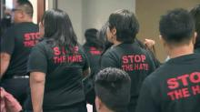 Protesters march out of meeting on immigration enforcement program