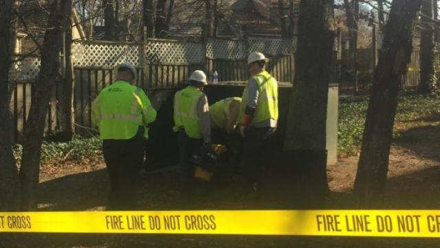Duke Energy crews were investigating a charred transmission box as the source of a power outage Tuesday that left more than 8,000 customers in the dark and tied up traffic in north Raleigh.