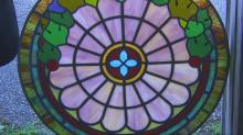 IMAGES: Stained glass company offers window to peace