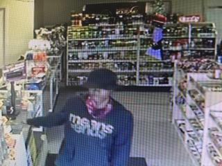 Fuquay-Varina police were searching Wednesday afternoon for a man wanted in the armed robbery of four people at a gas station on East Broad Street.
