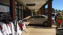 IMAGES: Car plows into front of Quail Ridge Books; no injuries reported