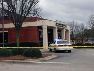 Cary police were searching Tuesday afternoon for a man they say robbed a Wells Fargo branch on Harrison Avenue.