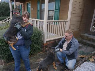 A family in Fayetteville escaped unharmed from their burning home early Wednesday, and they say it's all because of their two dogs.