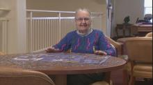 IMAGES: Puzzle lady finds peace among pieces