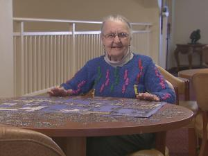 "90-year-old ""Puzzle Lady"" Elizabeth Baumgardner, a resident at a Wake Forest independent living community, spends four hours a day doing puzzles and has assembled hundreds since moving in."