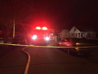 A woman was taken to the hospital on Wednesday morning with burns to her hands after a Raleigh house caught fire.