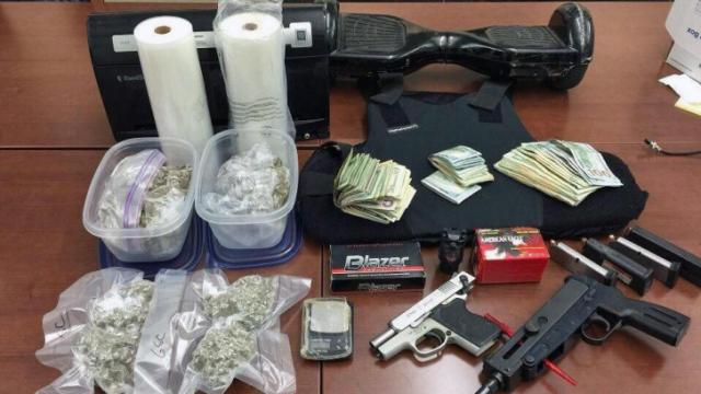 A Durham man was charged last week after sheriff's deputies seized more than 500 grams of marijuana, two guns, body armor and $4,700 in cash from his Village Circle Way apartment.