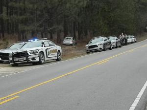 Authorities said that Derrick Delmont Malloy, 33, of West Wisconsin Avenue, was driving northbound on N.C. Highway 73 at about 2:15 p.m. when he was distracted by a North Carolina State Highway Patrol officer and struck a tree while exiting the roadway.