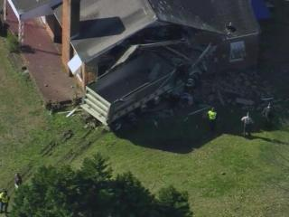 North Carolina State Highway Patrol troopers were investigating Monday morning after a dump truck plowed into a home in Angier.