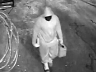 Authorities re-released surveillance photos Tuesday of a man wanted in connection with a September 2015 arson at Maverick's Saloon in Fayetteville.