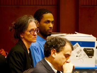 Travion Smith and his defense attorneys Phoebe Dee and Jonathan Broun.