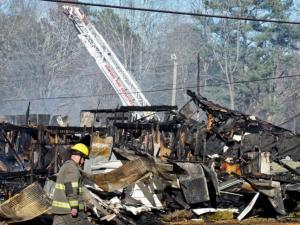 No one was injured on Sunday afternoon when three buildings in Sanford were destroyed by a fire.