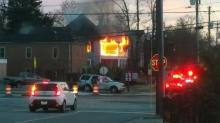 IMAGE: Investigators seek source of Fayetteville law firm fire