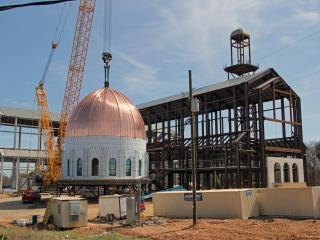 A custom-built crane will lift the 160-ton dome  into place atop the Holy Name of Jesus Cathedral in Raleigh.