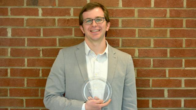 WRAL reporter Tyler Dukes is honored with a journalism award from the North Carolina Open Government Coalition on March 14, 2016.