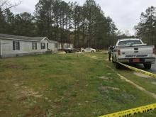 At least one person was killed and two others wounded on Saturday in a shooting at a home in Louisburg, officials said.