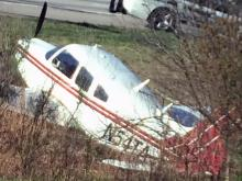 A single-engine airplane made an emergency landing Tuesday morning on the shoulder of Interstate 540 near Leesville Road in north Raleigh.
